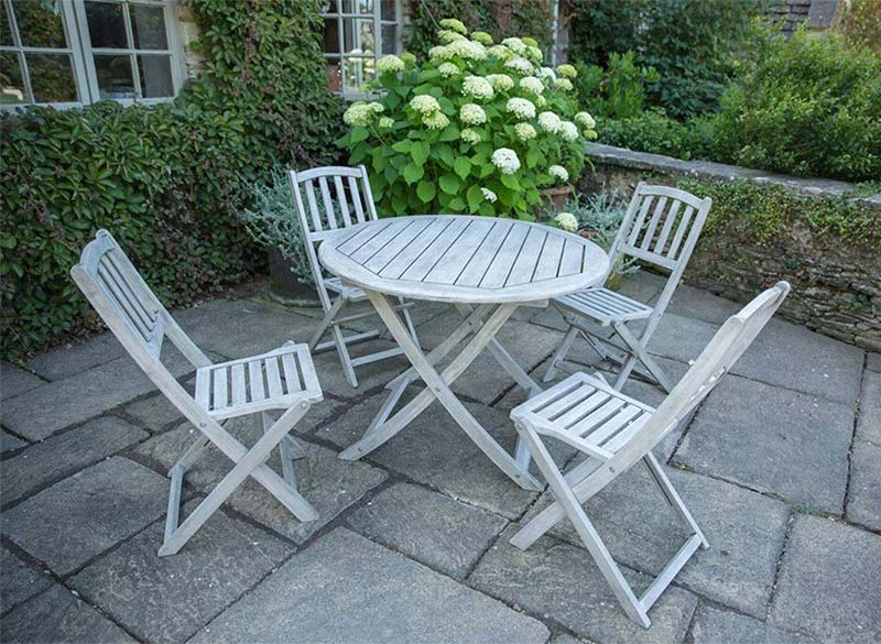Woodlodge 4 seat round dining table garden set available at Bumbles, April 2021